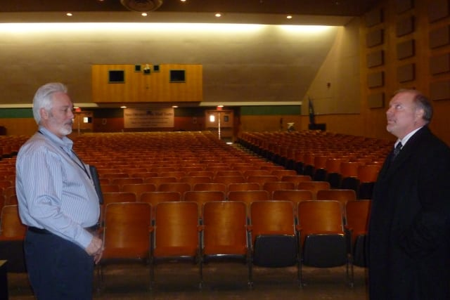 New Canaan Schools Facilities Director Bob Willoughby, left, and Visual and Performing Arts Director Alan Sneath meet inside the Saxe Middle School Auditorium.