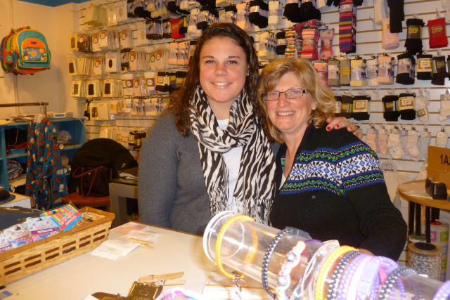 Candy Nichols, a children's clothing store in New Canaan, will move to 99 Main St. in March. Pictured here are co-owner Anna Carberry, right, and sales associate Jennifer Joseph.