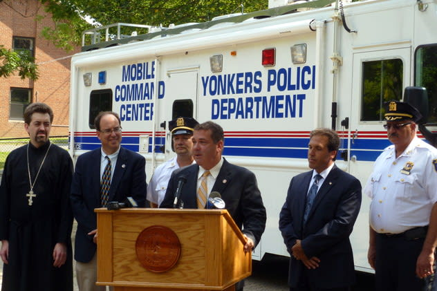 Residents have given an outpouring of support to keep Fourth Police Precinct Capt. John Mueller (third from left) at his position. Mueller joined city officials in Trinity Plaza in August for the launch of a neighborhood cleanup program.