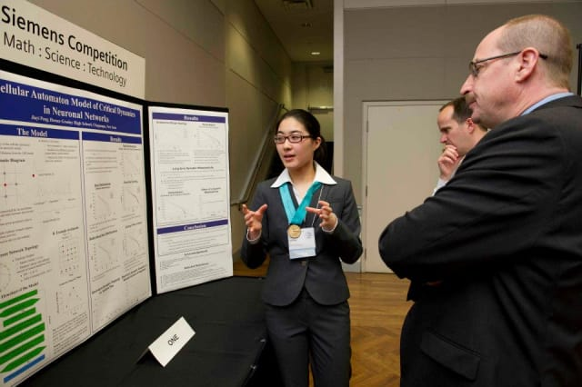 Horace Greeley senior Jiayi Peng, left, presents her cellular automation model for critical dynamics in neuronal networks project in the Intel Finals in Washington D.C. next month.