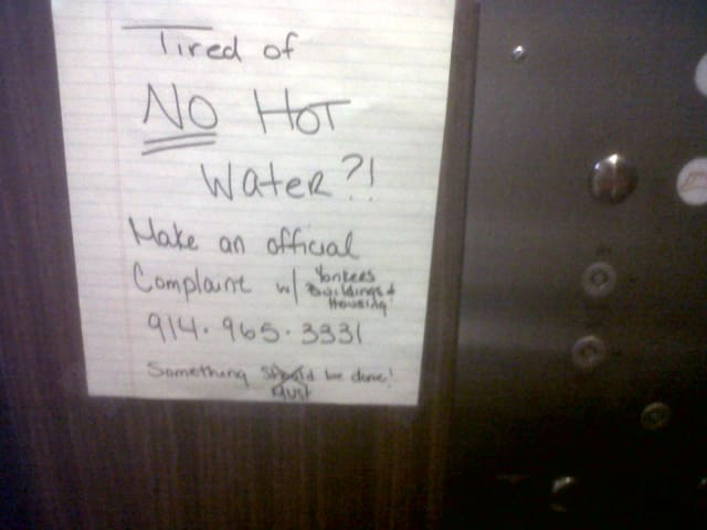 Yonkers' heat complaint hotline has received more than 200 calls from tenants, like the ones who posted this sign in a Van Cortlandt Park Avenue apartment building, who are fed up with a lack of hot water and heat.