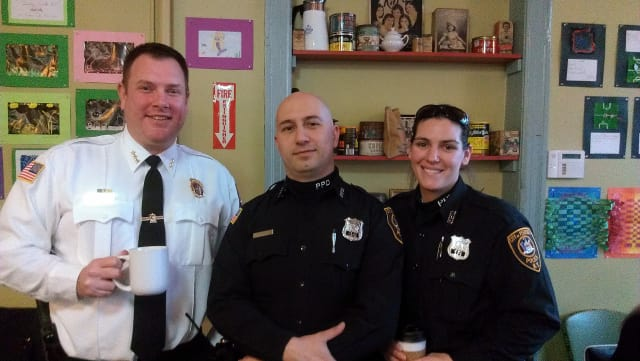 Peekskill Police Chief Eric Johansen and Officers Nick Franco and Pam Sgroi meet with residents at the Peekskill Coffee House on Monday.