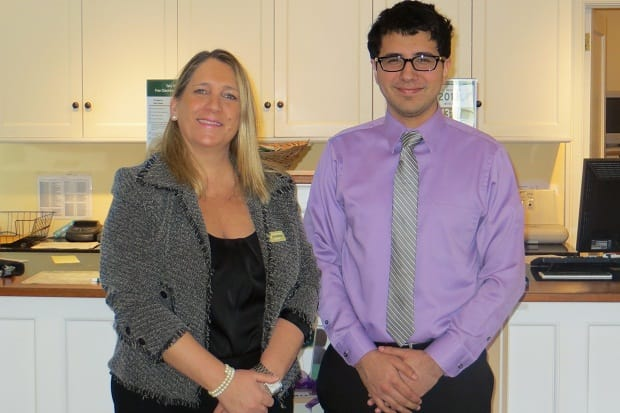 Elizabeth Buzzeo, manager of The Bank of New Canaan's Elm Street branch, with Marcelo Pena