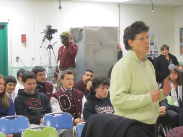 Jackie Kopera speaks about a plan to keep the Ossining Ice Hockey team during an Ossining School Board meeting Wednesday night.