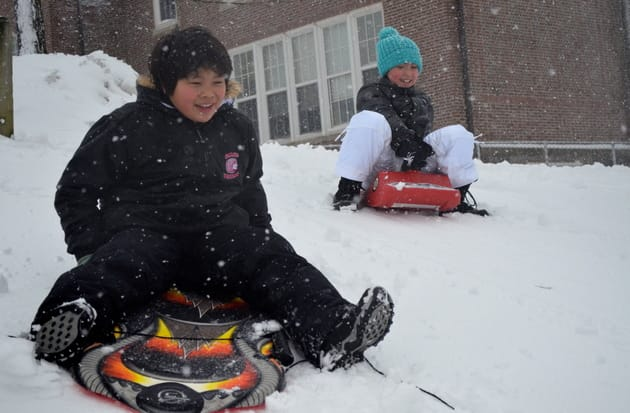 Children go sledding at Greens Farms School in Westport Friday afternoon.