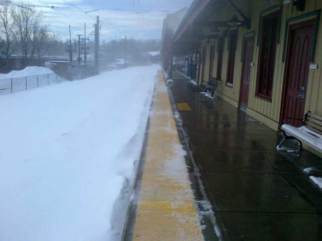 Metro-North train tracks were buried under snow at the New Canaan train station.
