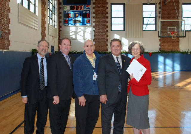 From left: Yonkers Council members Michael Sabatino and John Larkin, ANDRUS Executive VP Brian Farragher, Mayor Mike Spano and Nancy Woodruff Ment, CEO of ANDRUS, at ceremony in the newly renovated gym.