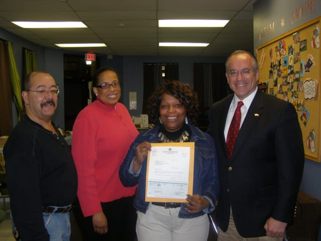(Left to right), ECAP Treasurer Jerod Yancy, Shivaun Carden and Area Director Charlene Lambrecht accept a grant from Town Supervisor Anthony Colavita, .
