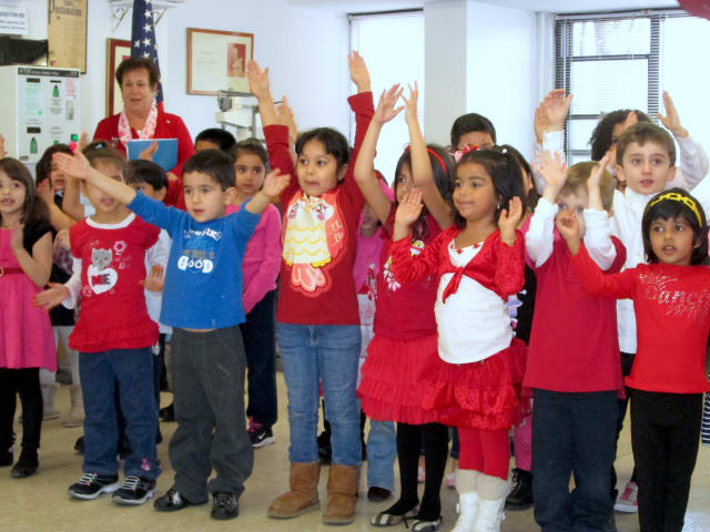 Students from Yonkers' Montessori School 31 sang for senior citizens to help spread holiday cheer on Valentine's Day.