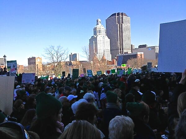 Thousands of people gather on the steps of the State Capitol in Hartford on Thursday to advocate for stricter gun control laws.