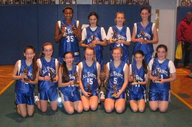 The varsity girls basketball team at All Saints Catholic School in Norwalk won the Tyler Ugolyn Tournament last weekend.
