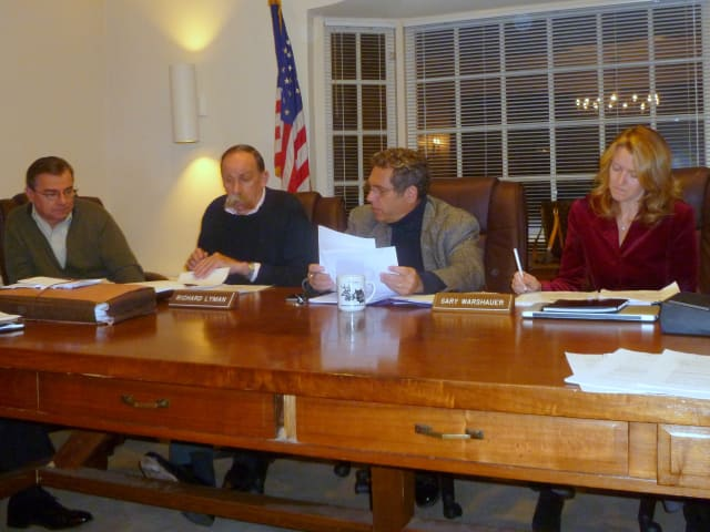 Members of the Pound Ridge Town Board discuss a plan to use police at Pound Ridge Elementary School.