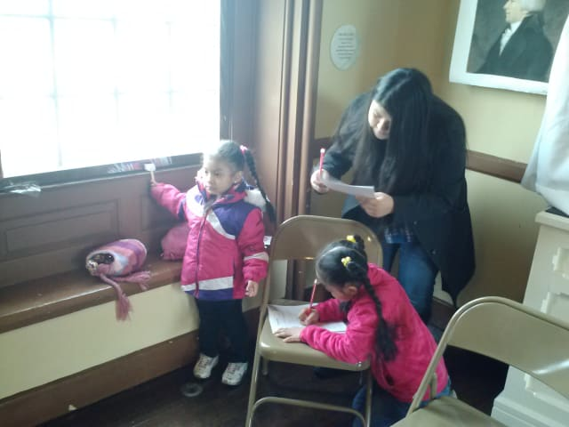 Socorro Tzompantzi and her children take part in a scavenger hunt for President's Day at Philipse Manor in Yonkers.
