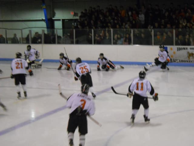 Mamaroneck, shown warming up before a period, will host Ryetown/Harrison in a quarterfinal game Tuesday in the Section 1 Division I Hockey Championships.