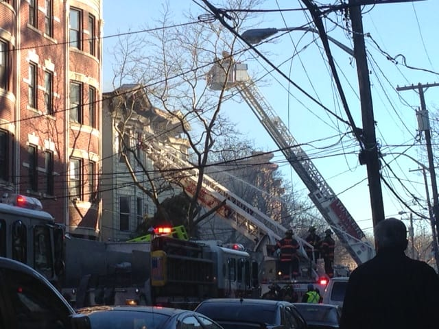 Yonkers firefighters battled a four-alarm fire Monday on Saratoga Avenue.