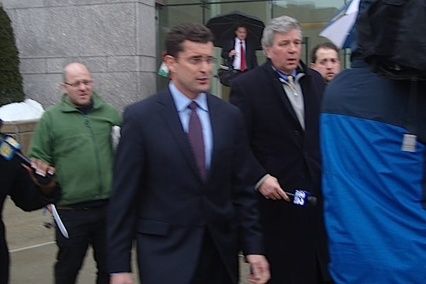 CBS anchor Rob Morrison walks through a crowd of reporters at court Tuesday, where he denied choking his wife at their Darien home.