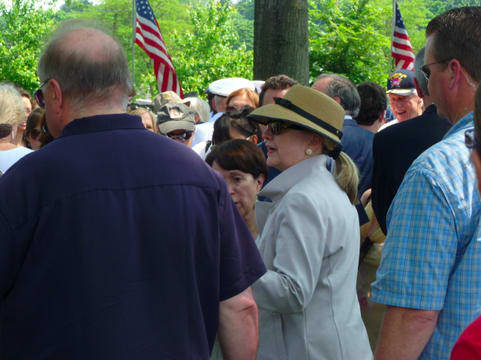 Chappaqua resident and former Secretary of State Hillary Clinton, seen here at New Castle's Memorial Day Parade last summer, will be joining the paid speaking circuit with the Harry Walker Agency.