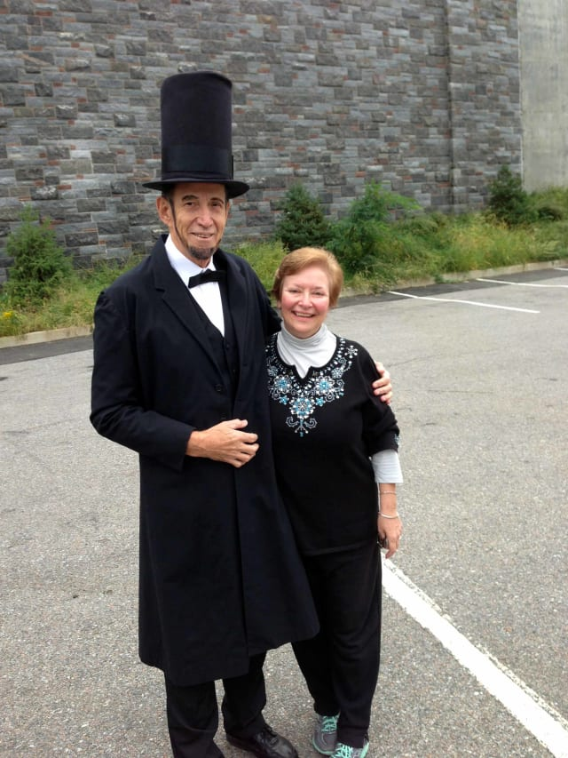 Catherine Pisani, a new member of the Lincoln Depot Foundation board of directors, with Abraham Lincoln, or at least a darn good likeness.