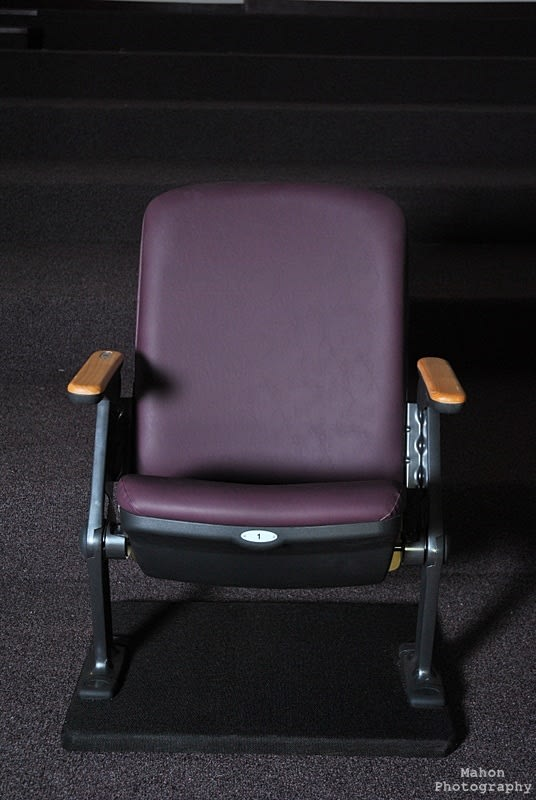The new seats being installed in the Ossie Davis Theater will have personalized nameplates on the armrests.