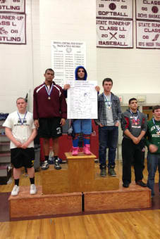 Immaculate High School wrestler Steve Ghossaini takes his spot at the top of the podium at the state wrestling championships.