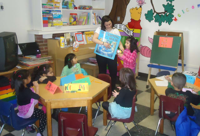 "First-graders read ""big"" books and craft their own story ideas at the Center for Literacy Enrichment in White Plains."