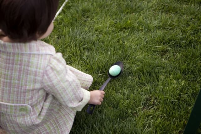 A young girl gets ready to roll her egg at the annual Easter Egg Roll on the South Lawn of the White House, April 5, 2010.