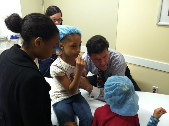 Amani Campbell from White Plains gets a check-up from Dr. Pete Richel Saturday at the Teddy Bear Clinic inside Northern Westchester Hospital in Mt. Kisco.