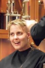 Katherine Price Sloan Snedaker had her hair cut off earlier this month. She is fighting breast cancer.