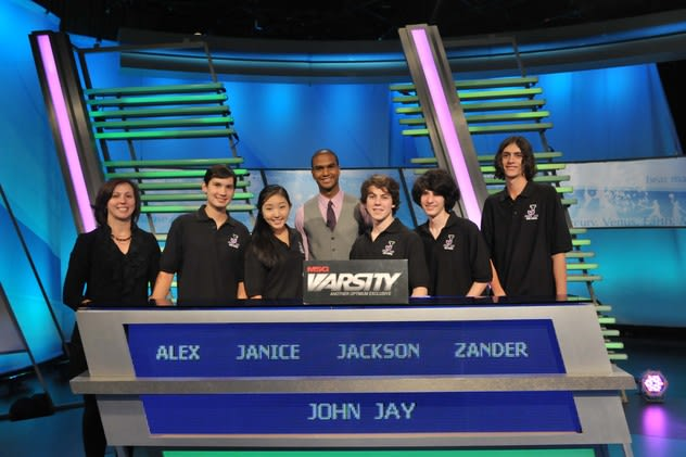 The John Jay High School team from left: academic adviser Vicky Weiss, Alex Lee, Janice Choi, 'The Challenge' host Jared Cotter, Jackson Ruzzo, Alexander Bolgar and Angelo Angelino.