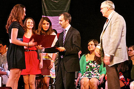 Harrison High School held a ceremony to induct 148 students into the National Foreign Language Honors Society.