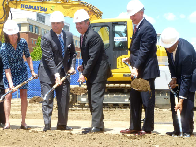 Mayor Michael Pavia and other dignitaries join Brian Grissler, president and CEO of Stamford Hospital, at a groundbreaking ceremony for the construction of a new hospital.