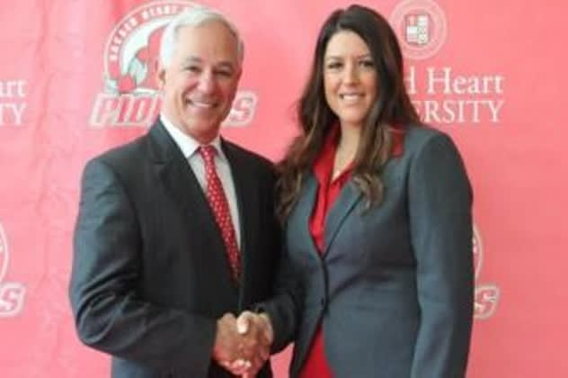 Jessica Mannetti of New Canaan is greeted by Sacred Heart University  Athletic Director Bobby Valentine at a press conference in Fairfield Tuesday.