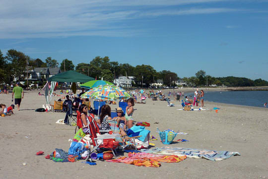 Visitors to Compo Beach in Westport enjoy the sun, but they should take steps to protect their skin against sunburn.
