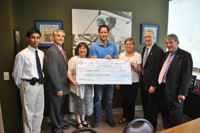State Sen. Greg Ball, center, presents a state grant to Lewisboro Library officials.