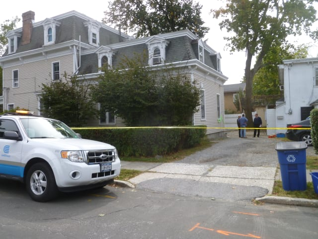 Police and Con Ed on the scene at a house in Tarrytown, where a woman was found dead after reports of a gas leak.