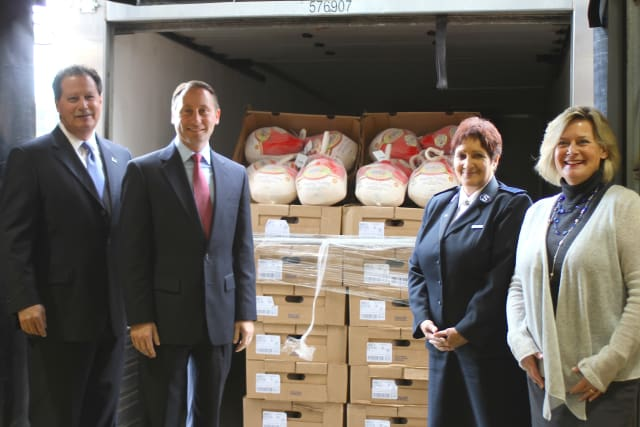 Rick Rakow, Food Bank for Westchester Board Chair; Westchester County Executive Rob Astorino; Captain Noel Rodriquez, Salvation Army Tarrytown Corps.; and Ellen Lynch, Executive Director of the Food Bank unload first batch of turkeys.
