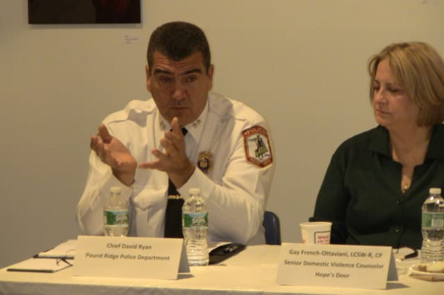 Pound Ridge Police Chief David Ryan, left, and Gay French-Ottaviani, senior counselor of Hope's Door, discuss domestic violence.