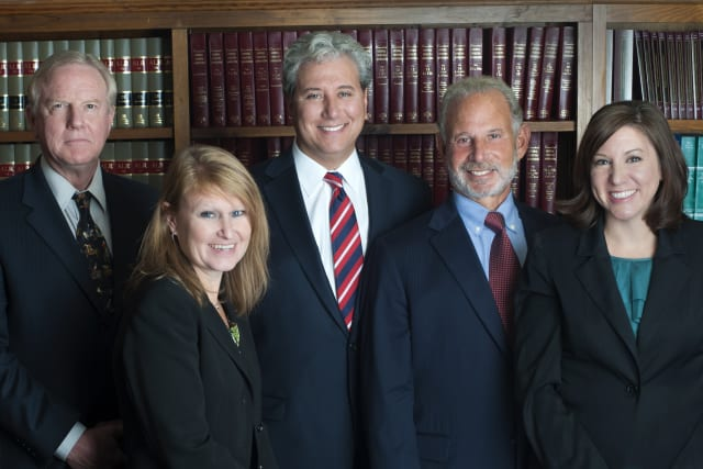 Westport law firm Nusbaum & Parrino attornies, from left, are senior associate attorney Harold W. Haldeman, senior associate attorney Laura R. Shattuck, co-founder Thomas P. Parrino, co-founder Edward Nusbaum and associate attorney Randi R. Nelson.