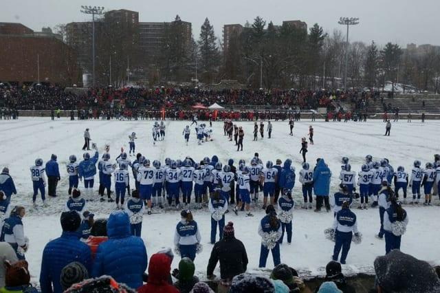 New Canaan beat Darien Saturday at snowy Boyle Stadium in Stamford the Class L football championship.