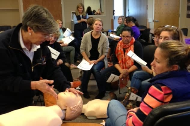 Joan Gildea, Darien EMS-Post 53 adult adviser and CPR director, (left, in EMT jacket), teaches staff from Playdates Preschool in CPR, AED and First Aid.