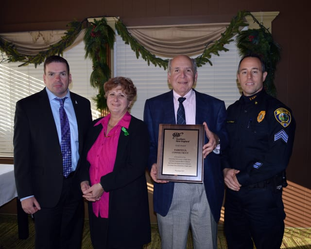 Public Affairs Manager Fran Mayko, second left, presented Chief Gary MacNamara, left, Police Commissioner Arthur Hirsch and Sgt. Robert Kalamaras with a Gold Award.