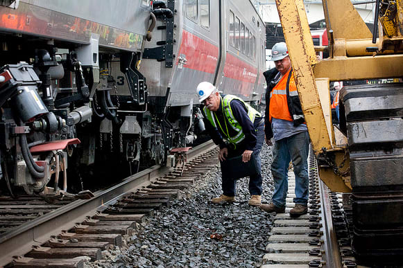 The National Transportation Safety Board inspects the scene of the first of two passenger-car derailments on Metro North trains in 2013.