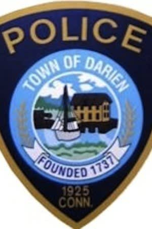 Darien Police issued an infraction to a Stamford man seen driving with a light pole sticking out of his car Saturday.