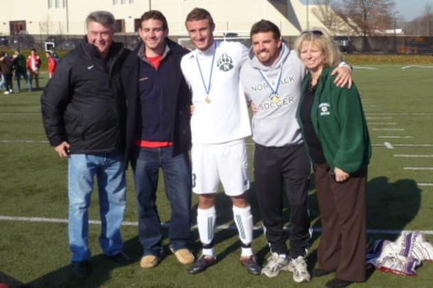 Dino Melitsanopoulos, left, stands with sons (left to right) Dean, Andrew and Paul and wife Martha after Norwalk HIgh won the state soccer championship in 2012.