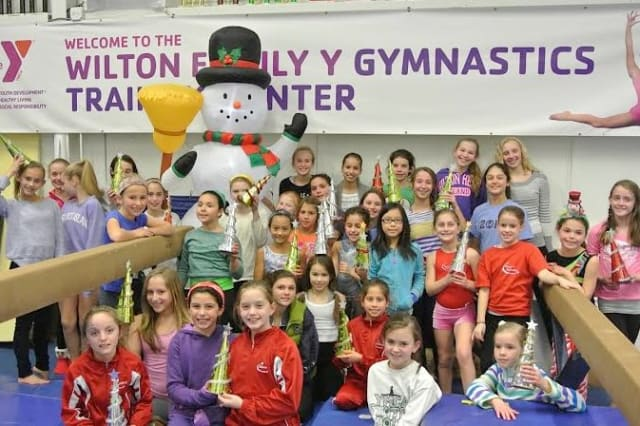 The Wilton Family YMCA Gymnastics Team celebrated the holidays with a party and made festive Christmas tree centerpieces for residents at Wilton Meadows.