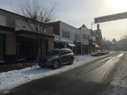 A lane of this street is plowed in downtown Westport, but few drivers are out on the roads.