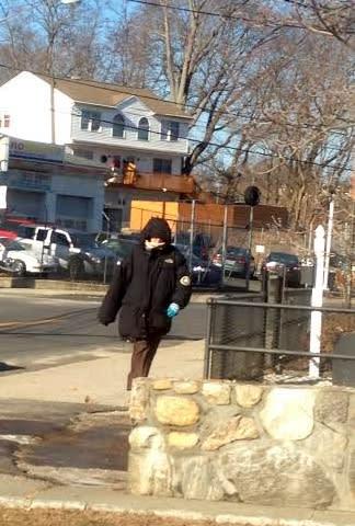 A Danbury pedestrian is bundled up Tuesday as bitter winds blow.