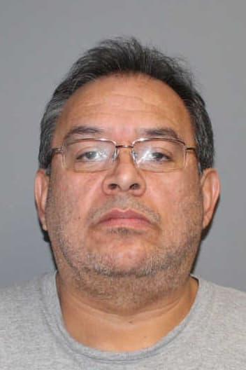 Carlos Perez, 54, of Norwalk was charged with reckless endangerment, risk of injury to a minor and unlawful discharge of a firearm Monday.