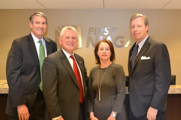 From left: Bruce Rogers, of Pierson & Smith; Norwalk Mayor Harry Rilling; Cathie Schaffer, First Niagara's Tri-state Regional President and David Ring, First Niagara New England Regional President at the opening of First Niagara's Norwalk office.