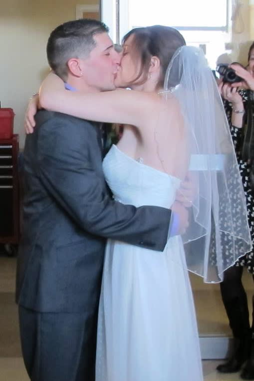 Greenwich High grads Anthony and Aly Femia kiss at their wedding at Yale-New Haven Hospital. They put their wedding together in 24 hours for Aly's dying mother.